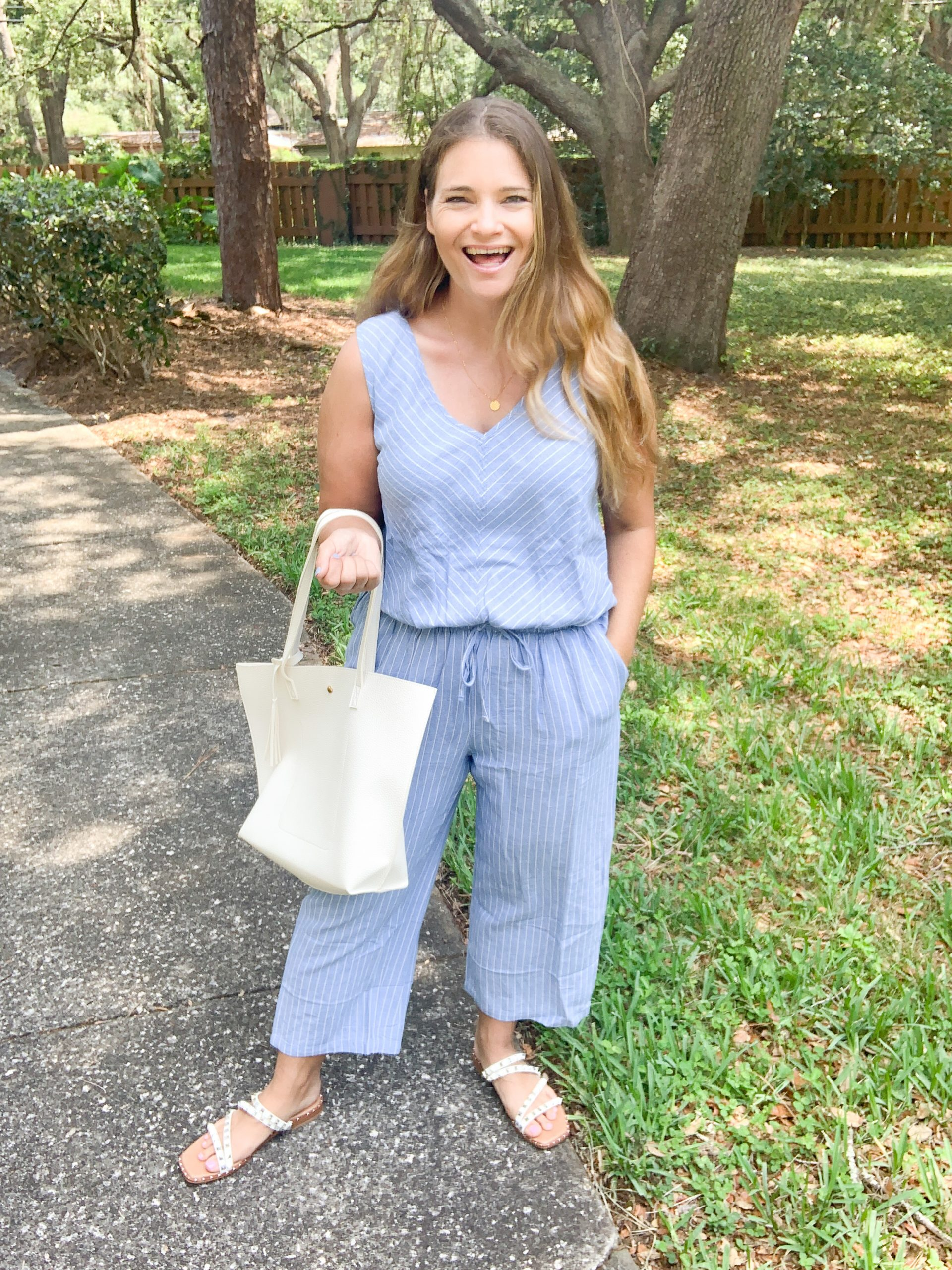 This affordable mom tote bag from Amazon is a must have! It comes in a wide variety of colors at a budget friendly price point. Outfit with Amazon pinstripe jumpsuit, white tote, and Steve Madden Skylar sandals.