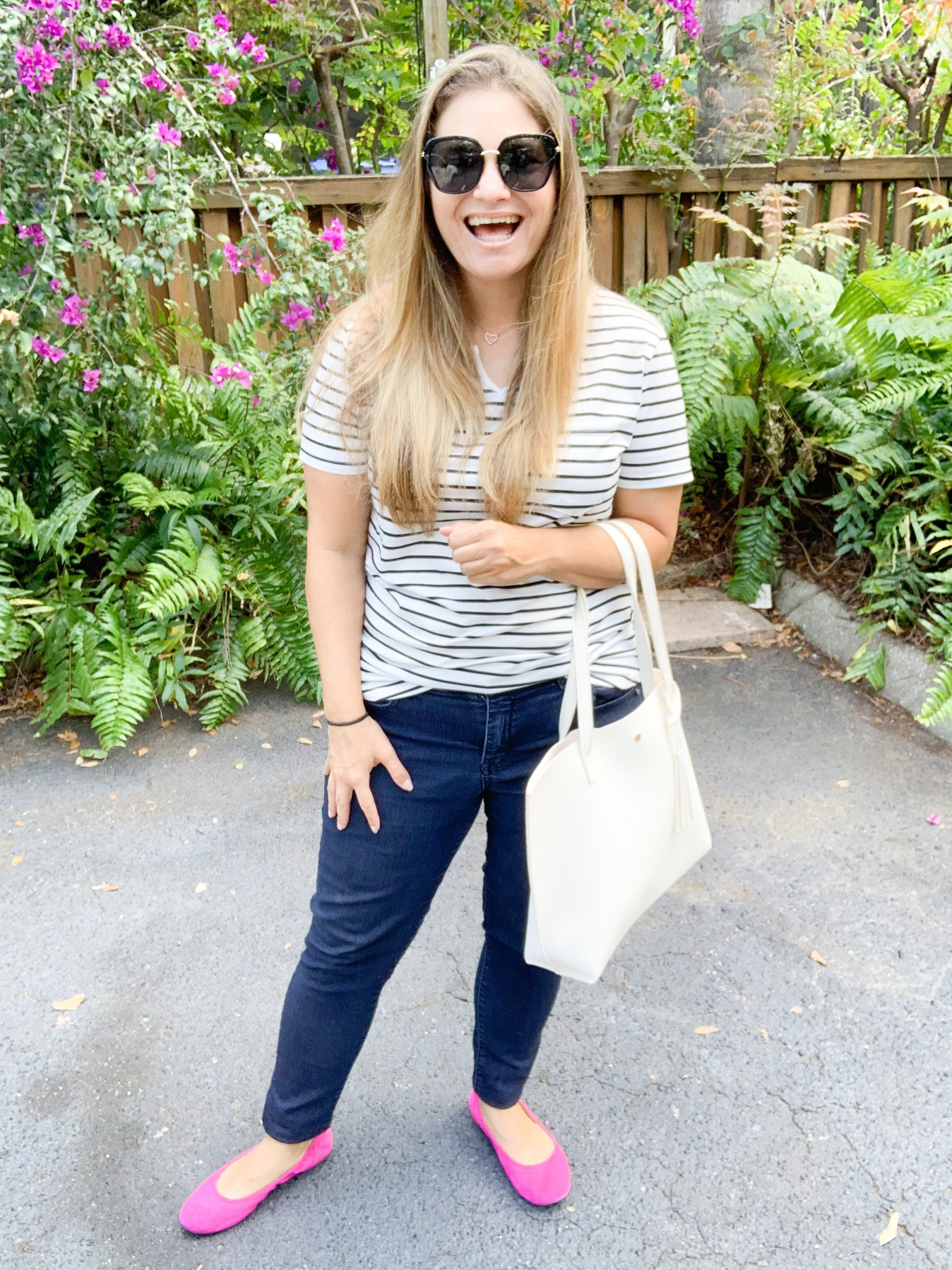 This affordable mom tote bag is a must have! It comes in a wide variety of colors at a budget friendly price point. Outfit with tote bag, ballet flats, jeans, and stripe tee.