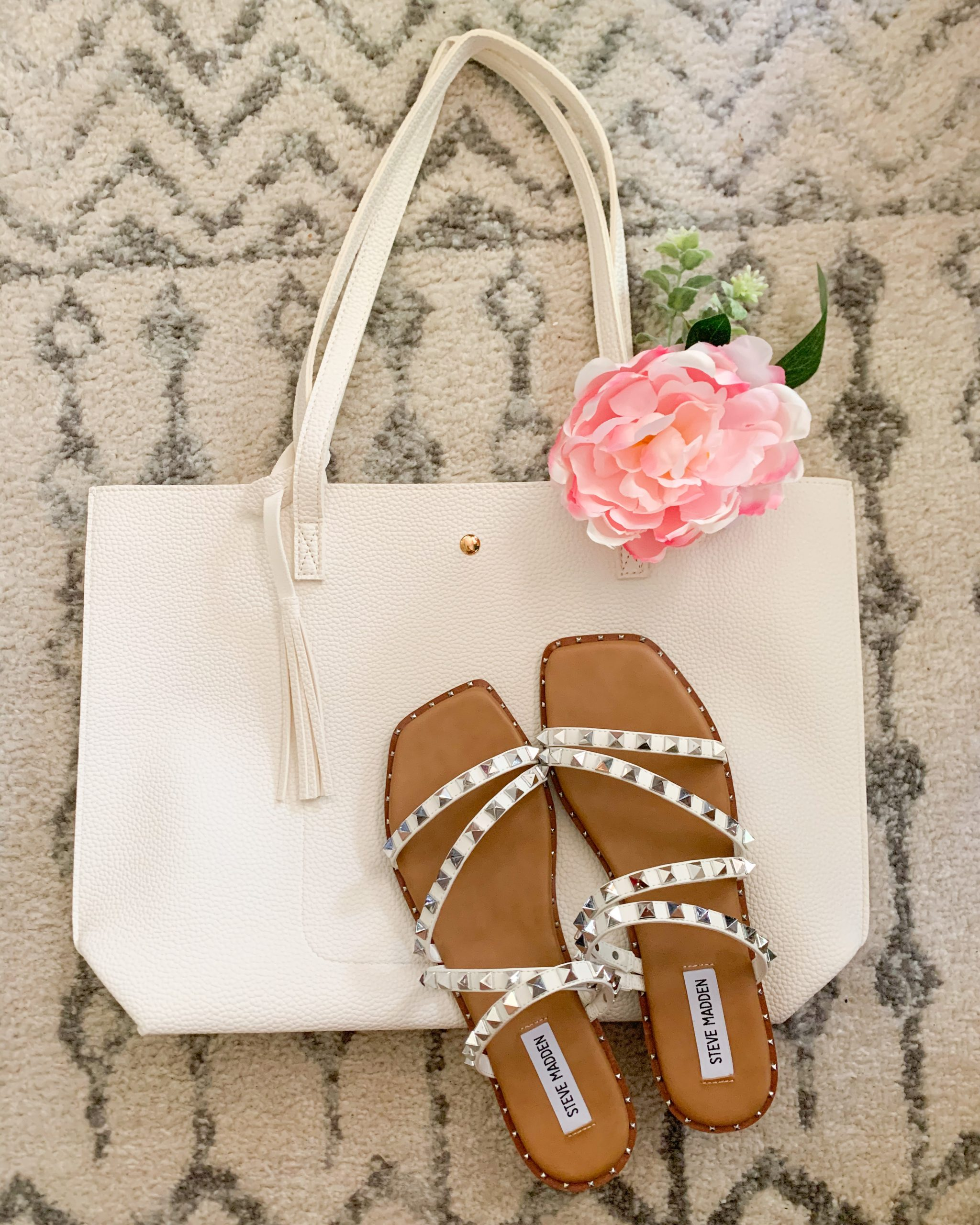 This affordable mom tote bag from Amazon is a must have! It comes in a wide variety of colors at a budget friendly price point. White tote bag and white Steve Madden Skylar studded sandals.